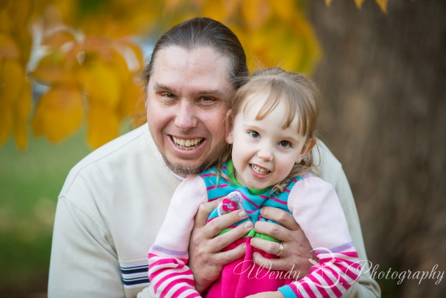 fall leaves dad and daughter portrait